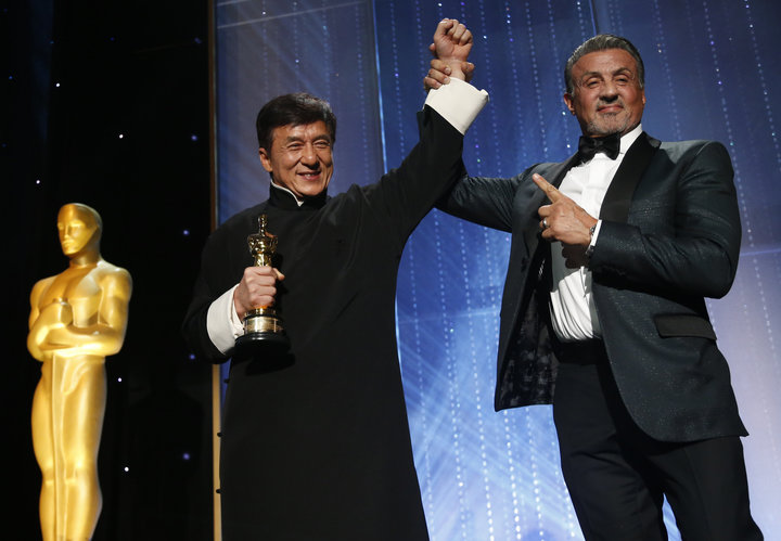 Actor Chan is congratulated by fellow actor Stallone after accepting his Honorary Award at the 8th Annual Governors Awards in Los Angeles